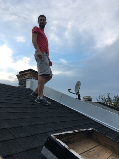 Standing on our new roof that keeps rain water out of our house!