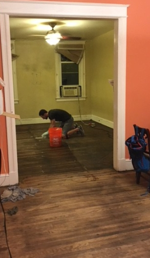 Note the difference in color between the two rooms. The room Jeremy is in is darker due to dirt/grime fused to the floors