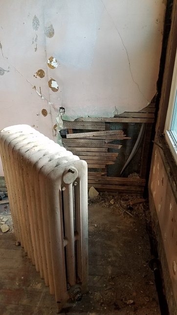 Don't mind the mess behind the radiator, it will soon be covered in a new wall!