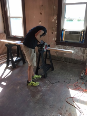 Using a circular saw to cut the 2X4s down to size