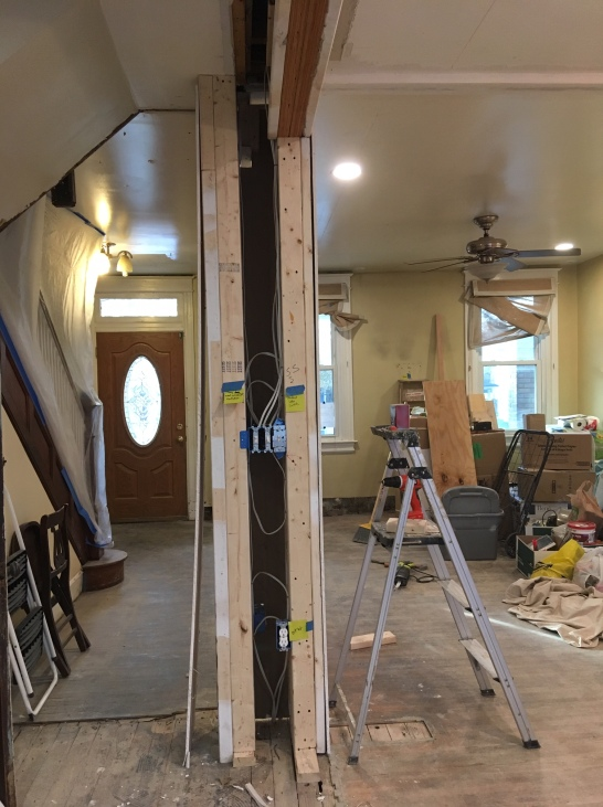 open column framing with newly wired switches and outlets