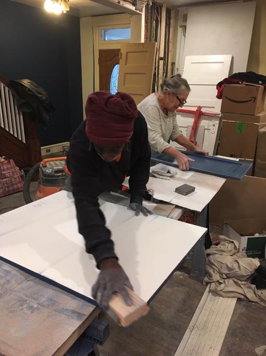 Cardinal and Joanie carefully sanding each piece